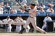 Jul 7, 2013; Bronx, NY, USA;  Baltimore Orioles right fielder Nick Markakis (21) singles to center during the ninth inning against the New York Yankees at Yankee Stadium. Baltimore Orioles won 2-1.  Mandatory Credit: Anthony Gruppuso-USA TODAY Sports