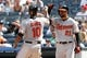 Jul 7, 2013; Bronx, NY, USA;  Baltimore Orioles center fielder Adam Jones (10) and right fielder Nick Markakis (21) celebrate scoring during the ninth inning against the New York Yankees at Yankee Stadium. Baltimore Orioles won 2-1.  Mandatory Credit: Anthony Gruppuso-USA TODAY Sports