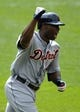Jul 7, 2013; Cleveland, OH, USA; Detroit Tigers right fielder Torii Hunter (48) celebrates his three-run home run in the eighth inning against the Cleveland Indians at Progressive Field. Mandatory Credit: David Richard-USA TODAY Sports