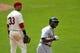 Jul 7, 2013; Cleveland, OH, USA; Detroit Tigers right fielder Torii Hunter (48) celebrates his three-run home run beside Cleveland Indians first baseman Nick Swisher (33) in the eighth inning at Progressive Field. Mandatory Credit: David Richard-USA TODAY Sports