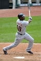 Jul 7, 2013; Cleveland, OH, USA; Detroit Tigers right fielder Torii Hunter (48) hits an RBI single in the seventh inning against the Cleveland Indians at Progressive Field. Mandatory Credit: David Richard-USA TODAY Sports