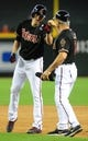 Jul 7, 2013; Phoenix, AZ, USA; Arizona Diamondbacks base runner Patrick Corbin (46) reacts with first base coach Steve Sax (5) after hitting a double in the sixth inning during a game against the Colorado Rockies at Chase Field. Mandatory Credit: Jennifer Hilderbrand-USA TODAY Sports