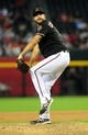 Jul 7, 2013; Phoenix, AZ, USA; Arizona Diamondbacks pitcher Josh Collmenter (55) pitches during the ninth inning during a game against the Colorado Rockies at Chase Field. Mandatory Credit: Jennifer Hilderbrand-USA TODAY Sports