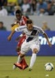 Jul 7, 2013; Carson, CA, USA; Los Angeles Galaxy midfielder Marcelo Sarvas (8) moves the ball defended by FC Dallas forward Fabian Castillo (11) during the first half at the StubHub Center. Mandatory Credit: Kelvin Kuo-USA TODAY Sports