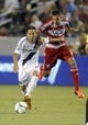 Jul 7, 2013; Carson, CA, USA; Los Angeles Galaxy midfielder Marcelo Sarvas (8) and FC Dallas forward Blas P  rez (7) battle for the ball during the second half at the StubHub Center. The Los Angeles Galaxy defeated the FC Dallas 2-0. Mandatory Credit: Kelvin Kuo-USA TODAY Sports