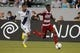 Jul 7, 2013; Carson, CA, USA; FC Dallas forward Fabian Castillo (11) moves down the field defended by Los Angeles Galaxy defender Sean Franklin (5) during the first half at the StubHub Center. Mandatory Credit: Kelvin Kuo-USA TODAY Sports