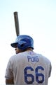 July 6, 2013; San Francisco, CA, USA; Los Angeles Dodgers right fielder Yasiel Puig (66) stands on deck during the eighth inning against the San Francisco Giants at AT&T Park. The Giants defeated the Dodgers 4-2. Mandatory Credit: Kyle Terada-USA TODAY Sports