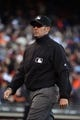 July 6, 2013; San Francisco, CA, USA; MLB umpire Manny Gonzalez (79) looks on after the game between the San Francisco Giants and the Los Angeles Dodgers at AT&T Park. The Giants defeated the Dodgers 4-2. Mandatory Credit: Kyle Terada-USA TODAY Sports