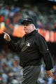 July 6, 2013; San Francisco, CA, USA; MLB umpire Brian Gorman (9) signals after the game between the San Francisco Giants and the Los Angeles Dodgers at AT&T Park. The Giants defeated the Dodgers 4-2. Mandatory Credit: Kyle Terada-USA TODAY Sports