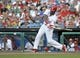 Jul 8, 2013; Philadelphia, PA, USA; Philadelphia Phillies left fielder Domonic Brown (9) hits an RBI single against the Washington Nationals in the first inning at Citizens Bank Park. Mandatory Credit: Eric Hartline-USA TODAY Sports
