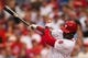 Jul 9, 2013; Philadelphia, PA, USA; Philadelphia Phillies left fielder Domonic Brown (9) hits an RBI single during the fourth inning against the Washington Nationals at Citizens Bank Park. Mandatory Credit: Howard Smith-USA TODAY Sports