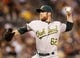 Jul 9, 2013; Pittsburgh, PA, USA; Oakland Athletics relief pitcher Sean Doolittle (62) pitches against the Pittsburgh Pirates during the seventh inning at PNC Park. The Oakland Athletics won 2-1. Mandatory Credit: Charles LeClaire-USA TODAY Sports