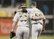 Jul 9, 2013; Pittsburgh, PA, USA; Oakland Athletics catcher Derek Norris (36) and relief pitcher Grant Balfour (50) embrace as the leave the field after defeating the Pittsburgh Pirates at PNC Park. The Oakland Athletics won 2-1. Mandatory Credit: Charles LeClaire-USA TODAY Sports