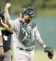 Jul 9, 2013; Pittsburgh, PA, USA; Oakland Athletics catcher Derek Norris (36) reacts while leaving the field after defeating the Pittsburgh Pirates at PNC Park. The Oakland Athletics won 2-1. Mandatory Credit: Charles LeClaire-USA TODAY Sports