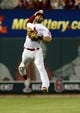 Jul 9, 2013; St. Louis, MO, USA; St. Louis Cardinals shortstop Daniel Descalso (33) leaps and throws unsuccessfully on a ball hit by Houston Astros third baseman Matt Dominguez (not pictured) during the ninth inning at Busch Stadium. St. Louis defeated Houston 9-5. Mandatory Credit: Jeff Curry-USA TODAY Sports