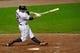 Jul 8, 2013; Cleveland, OH, USA; Cleveland Indians third baseman Mark Reynolds (12) singles during a game against the Detroit Tigers at Progressive Field. Detroit won 4-2. Mandatory Credit: David Richard-USA TODAY Sports