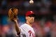 Jul 10, 2013; Philadelphia, PA, USA; Philadelphia Phillies pitcher Cliff Lee (33) gets a new ball after giving up a home run during the fifth inning against the Washington Nationals at Citizens Bank Park. Mandatory Credit: Howard Smith-USA TODAY Sports