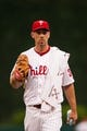 Jul 10, 2013; Philadelphia, PA, USA; Philadelphia Phillies pitcher Cliff Lee (33) walks in from the bullpen prior to playing the Washington Nationals at Citizens Bank Park. The Nationals defeated the Phillies 5-1. Mandatory Credit: Howard Smith-USA TODAY Sports
