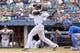 Jul 11, 2013; Bronx, NY, USA; New York Yankees shortstop Eduardo Nunez (26) hits an RBI single against the Kansas City Royals during the fifth inning of a game at Yankee Stadium. Mandatory Credit: Brad Penner-USA TODAY Sports