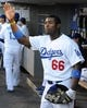 Jul 12, 2013; Los Angeles, CA, USA;  Los Angeles Dodgers right fielder Yasiel Puig (66) in the dugout before the game against the Colorado Rockies at Dodger Stadium.Mandatory Credit: Jayne Kamin-Oncea-USA TODAY Sports