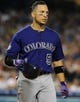 Jul 12, 2013; Los Angeles, CA, USA;  Colorado Rockies left fielder Carlos Gonzalez (5) during the game against the Los Angeles Dodgers at Dodger Stadium.Mandatory Credit: Jayne Kamin-Oncea-USA TODAY Sports