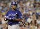 Jul 12, 2013; Los Angeles, CA, USA;  Colorado Rockies starting pitcher Juan Nicasio (12) at bat during the game against the Los Angeles Dodgers at Dodger Stadium.Mandatory Credit: Jayne Kamin-Oncea-USA TODAY Sports
