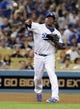 Jul 12, 2013; Los Angeles, CA, USA;  Los Angeles Dodgers third baseman Juan Uribe (5) makes a play during the game against the Colorado Rockies at Dodger Stadium.Mandatory Credit: Jayne Kamin-Oncea-USA TODAY Sports
