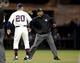 Jul 12, 2013; San Diego, CA, USA; San Diego Padres manager Bud Black (20) is thrown out of the game by second base umpire Laz Diaz (63) after a play during the seventh inning against the San Francisco Giants at Petco Park. Mandatory Credit: Christopher Hanewinckel-USA TODAY Sports