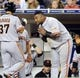 Jul 12, 2013; San Diego, CA, USA; San Francisco Giants third baseman Pablo Sandoval (48) congratulates left fielder Kensuke Tanaka (37) after scoring during the seventh inning against the San Diego Padres at Petco Park. Mandatory Credit: Christopher Hanewinckel-USA TODAY Sports