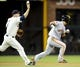 Jul 12, 2013; San Diego, CA, USA; San Diego Padres third baseman Chase Headley (7) tosses the ball over San Francisco Giants left fielder Kensuke Tanaka (37) during a rundown in the seventh inning at Petco Park. Mandatory Credit: Christopher Hanewinckel-USA TODAY Sports