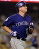 Jul 12, 2013; Los Angeles, CA, USA;  Colorado Rockies first baseman Jordan Pacheco (15) runs to first base during the game against the Los Angeles Dodgers at Dodger Stadium. Rockies won 3-0. Mandatory Credit: Jayne Kamin-Oncea-USA TODAY Sports