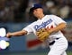 Jul 12, 2013; Los Angeles, CA, USA;  Los Angeles Dodgers second baseman Mark Ellis (14) makes an out in the eighth inning of the game against the Colorado Rockies at Dodger Stadium. Rockies won 3-0. Mandatory Credit: Jayne Kamin-Oncea-USA TODAY Sports