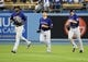 Jul 12, 2013; Los Angeles, CA, USA;  Colorado Rockies center fielder Dexter Fowler (24), left fielder Carlos Gonzalez (5) and right fielder Charlie Blackmon (19) run off the field after the game against the Los Angeles Dodgers at Dodger Stadium. Rockies won 3-0. Mandatory Credit: Jayne Kamin-Oncea-USA TODAY Sports