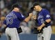 Jul 12, 2013; Los Angeles, CA, USA;  Colorado Rockies relief pitcher Rafael Betancourt (63) and left fielder Carlos Gonzalez (5) after the game against the Los Angeles Dodgers at Dodger Stadium. Rockies won 3-0. Mandatory Credit: Jayne Kamin-Oncea-USA TODAY Sports