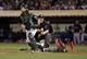 Jul 12, 2013; Oakland, CA, USA; Home plate umpire umpire Bill Miller (26) calls the out by Oakland Athletics catcher John Jaso (5) against Boston Red Sox pinch runner Jackie Bradley Jr. (44) during the ninth inning at O.co Coliseum. Mandatory Credit: Kelley L Cox-USA TODAY Sports