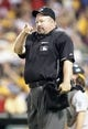 Jul 9, 2013; Pittsburgh, PA, USA; Home plate umpire Wally Bell (35) gestures on the field in the contest between the Oakland Athletics and the Pittsburgh Pirates during the third inning at PNC Park. The Oakland Athletics won 2-1. Mandatory Credit: Charles LeClaire-USA TODAY Sports