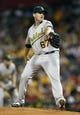 Jul 9, 2013; Pittsburgh, PA, USA; Oakland Athletics starting pitcher Dan Straily (67) delivers a pitch against the Pittsburgh Pirates during the first inning at PNC Park. The Oakland Athletics won 2-1. Mandatory Credit: Charles LeClaire-USA TODAY Sports