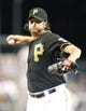 Jul 9, 2013; Pittsburgh, PA, USA; Pittsburgh Pirates relief pitcher Jason Grilli (39) pitches against the Oakland Athletics during the ninth inning at PNC Park. The Oakland Athletics won 2-1. Mandatory Credit: Charles LeClaire-USA TODAY Sports