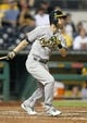 Jul 9, 2013; Pittsburgh, PA, USA; Oakland Athletics right fielder Josh Reddick (16) at bat against the Pittsburgh Pirates during the eighth inning at PNC Park. The Oakland Athletics won 2-1. Mandatory Credit: Charles LeClaire-USA TODAY Sports