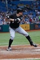 Jul 5, 2013; St. Petersburg, FL, USA; Chicago White Sox second baseman Jeff Keppinger (7) at bat against the Tampa Bay Rays at Tropicana Field. Mandatory Credit: Kim Klement-USA TODAY Sports