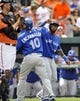 Jul 13, 2013; Baltimore, MD, USA; Toronto Blue Jays first baseman Edwin Encarnacion (10) is congratulated Jose Reyes (7) after hitting a two-run home run in the first inning against the Baltimore Orioles at Oriole Park at Camden Yards. Mandatory Credit: Joy R. Absalon-USA TODAY Sports
