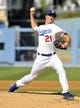 July 13, 2013; Los Angeles, CA, USA; Los Angeles Dodgers starting pitcher Zack Greinke (21) pitches during the second inning against the Colorado Rockies at Dodger Stadium. Mandatory Credit: Gary A. Vasquez-USA TODAY Sports