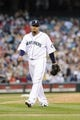 Jul 13, 2013; Seattle, WA, USA; Seattle Mariners starting pitcher Felix Hernandez (34) during the game against the Los Angeles Angels at Safeco Field. Seattle defeated Los Angeles 6-0. Mandatory Credit: Steven Bisig-USA TODAY Sports