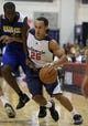 Jul 13, 2013; Las Vegas, NV, USA; Washington Wizards guard Andrew Lawrence (26) dribbles the ball as Golden State Warriors forward Dwayne Davis defends during the second half of an NBA Summer League game at Cox Pavillon. Mandatory Credit: Stephen R. Sylvanie-USA TODAY Sports