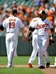 Jul 14, 2013; Baltimore, MD, USA; Baltimore Orioles teammates Chris Davis (19) and Nick Markakis (21) celebrate after a game against the Toronto Blue Jays at Oriole Park at Camden Yards. The Orioles defeated the Blue Jays 7-4. Mandatory Credit: Joy R. Absalon-USA TODAY Sports