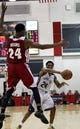 Jul 14, 2013; Las Vegas, NV, USA; Cleveland Cavaliers guard Corey Higgins leaps in the air in attempt to block an incoming pass by Memphis Grizzlies guard Gerald Robinson during an NBA Summer League game at Cox Pavillion. Cleveland won the game 69-58. Mandatory Credit: Stephen R. Sylvanie-USA TODAY Sports