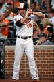 Jul 10, 2013; Baltimore, MD, USA; Baltimore Orioles first baseman Chris Davis (19) in the on-deck circle during the third inning against the Texas Rangers at Oriole Park at Camden Yards. The Orioles defeated the Rangers 6-1. Mandatory Credit: Joy R. Absalon-USA TODAY Sports
