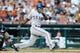 July 12, 2013; Detroit, MI, USA; Texas Rangers second baseman Jurickson Profar (13) hits an RBI single fourth inning against the Detroit Tigers at Comerica Park. Mandatory Credit: Rick Osentoski-USA TODAY Sports