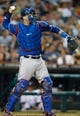 July 13, 2013; Detroit, MI, USA; Texas Rangers catcher A.J. Pierzynski (12) makes a throw against the Detroit Tigers at Comerica Park. Mandatory Credit: Rick Osentoski-USA TODAY Sports
