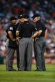 July 12, 2013; Detroit, MI, USA; MLB umpires Quinn Wolcott, Scott Barry, Tim Welke, Mike Everittat have a meeting during the game between the Detroit Tigers and the Texas Rangers Comerica Park. Mandatory Credit: Rick Osentoski-USA TODAY Sports